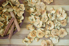 Apples. Dried apples with cinnamon on a wooden board Stock Images