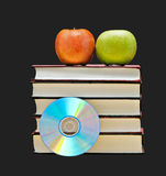 Apples, dvd, and  books Royalty Free Stock Photos