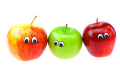 Apples with eyes and faces isolated on white Royalty Free Stock Photos