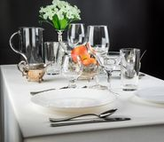 Apples with glasses and cutlery Stock Images