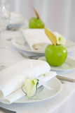 Apples and flower on plates. Celebratory laying in white and green color Royalty Free Stock Photography