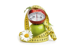 Apples, Flowers And Measuring Tape. Royalty Free Stock Photography