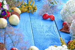 Apples, flowers, leaf litters and plums on a wood table Royalty Free Stock Photo