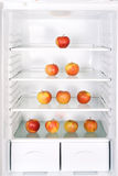 Apples in fridge Stock Images