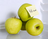 Apples on fridge shelf Royalty Free Stock Photos