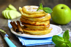 Apples fried in a batter. Apples fried in a batter on wooden table stock photography