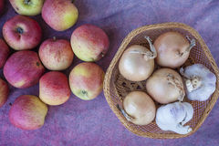 Apples, garlic and onion on cloth Royalty Free Stock Photo