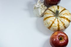 Apples garlic and pumpkin. Apples pumpkin and garlic on a white background Stock Photography