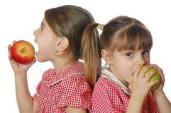 Apples and girls Royalty Free Stock Image
