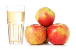 Apples a glass of apple juice. On white background isolation Royalty Free Stock Photo