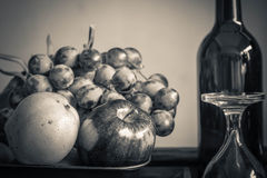 Apples and a glass with black and white. Stock Image