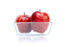 Apples in glass bow. Isolated on white Stock Photo