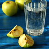 Apples and glass Royalty Free Stock Photos