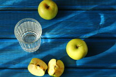 Apples and glass Royalty Free Stock Image