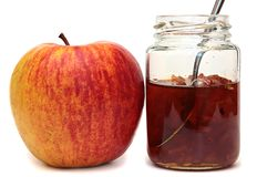 Apples and glass jar with jam Royalty Free Stock Images