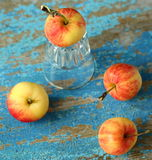 Apples. And glasses on table Royalty Free Stock Photo