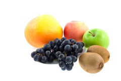 Apples, grapefruit, kiwi-fruits and grapes Stock Photo