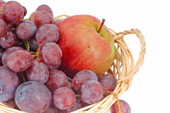 Apples and grapes in a baske Royalty Free Stock Image