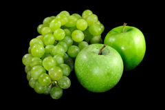Apples and grapes on  black background Royalty Free Stock Photos