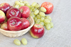 Apples and grapes Stock Images