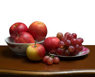 Apples and grapes Stock Photos