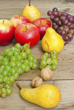 Apples grapes and pears, wooden table Stock Image