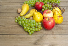 Apples grapes and pears, wooden table Stock Photo