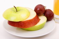 Apples and grapes on plate Stock Photos