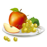 Apples and grapes on a platter Royalty Free Stock Photography