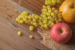 Apples and grapes on the table. Royalty Free Stock Photo