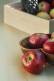 Apples and grapes in a wooden box, close up Stock Images
