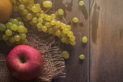 Apples and grapes on wooden Stock Photo