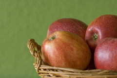 Apples before green background Royalty Free Stock Photos