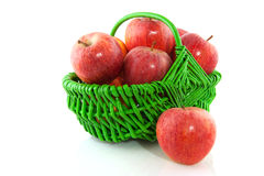 Apples in green basket Stock Photos