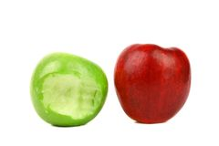 Apples. Green bitten and red. Stock Photos