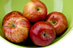 Apples in a green bowl Royalty Free Stock Images