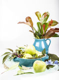 green apples setting with blue ceramic pots Stock Photo