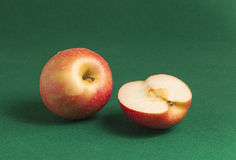 Apples on Green. View of a red apples on a green background Stock Images