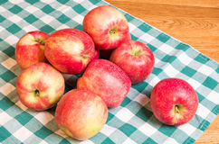 Apples on green and white cloth Stock Photography
