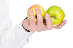 Apples in hand Stock Photography