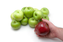 Apples and hand. Green apples on white and red apple in hand of man royalty free stock images