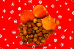 Apples an hazelnuts on christmas background stock photography