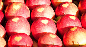 Apples with heart Stock Images