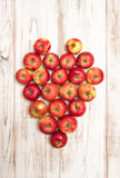 Apples heart over wooden background. Love concept Royalty Free Stock Photo