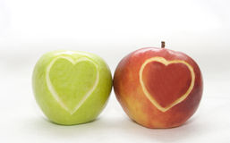 Apples with hearts. The image of two apples on which hearts are cut out Royalty Free Stock Images