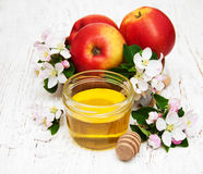 Apples with honey Royalty Free Stock Images