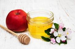 Apples with honey Stock Photos