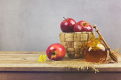 Apples and honey jar on wooden table. Jewish Rosh Hashanah holiday background Royalty Free Stock Image
