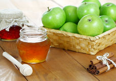 Apples and honey in jars Royalty Free Stock Photography