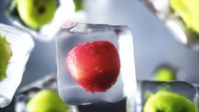 Apples in ice cubes. Food and broadcast concept. Realistic ice materials. 3d rendering. Apples in ice cubes. Food and broadcast concept. Realistic ice materials Royalty Free Stock Photography